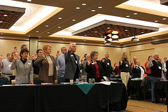 members take the oath at a board meeting