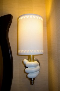 Mickey Mouse's Gloved Hands Holding the Light at the Disneyland Hotel