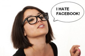 "Girl in Glasses with Thought Bubble that Reads: ""I Hate Facebook!"""