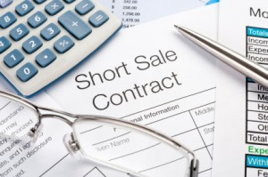 Short sale contract Form with pen, calculator