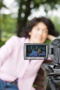 Video camera and woman